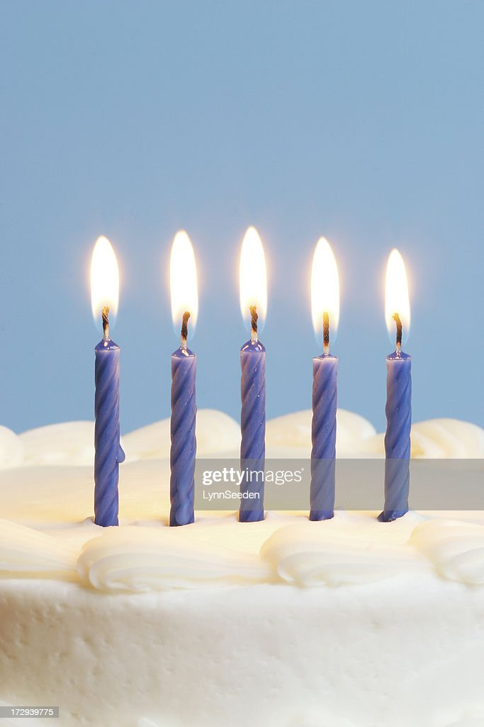 Blue candles on white cake : Stock Photo