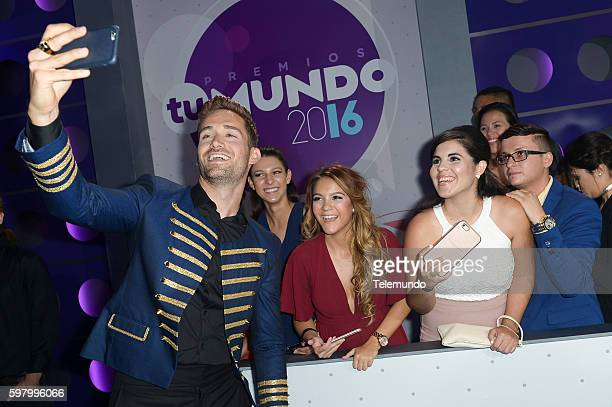 MUNDO 2016 'Blue Carpet' Pictured Mauricio Henao arrives at the 2016 Premios Tu Mundo at the American Airlines Arena in Miami Florida on August 25...