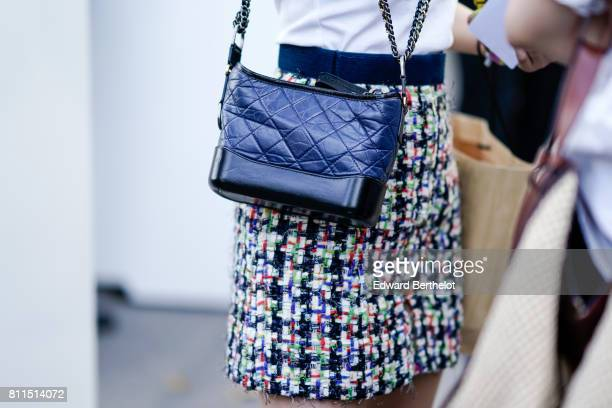 A blue Chanel bag and a multicolor tweed skirt during Paris Fashion Week Haute Couture Fall/Winter 20172018 on July 4 2017 in Paris France