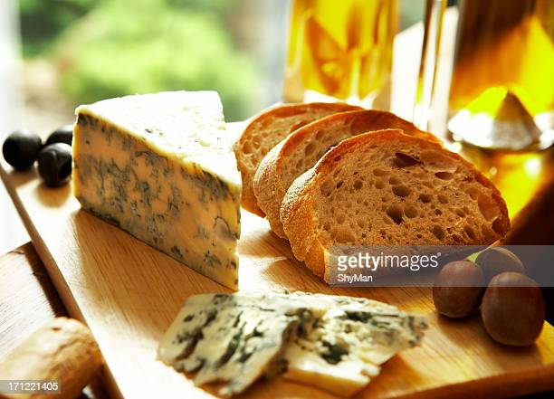 Blue cheese setting with bread and chestnuts on wooden board
