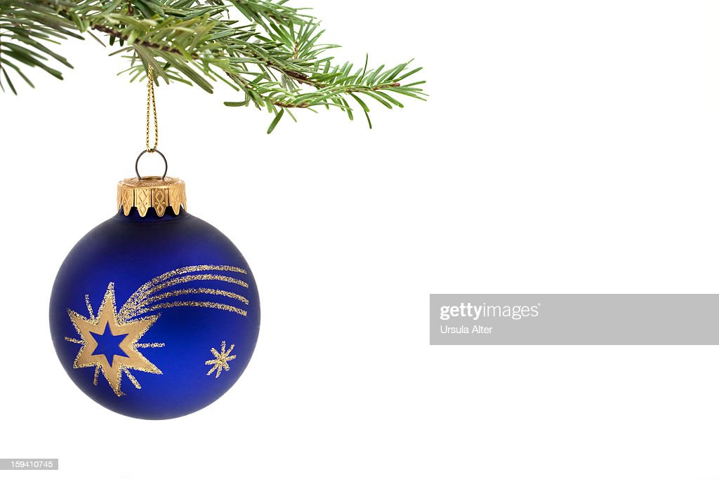 Blue Christmas Bauble Hanging On A Tree Stock Photo
