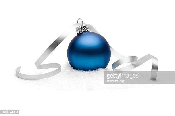 Blue christmas bauble on snow