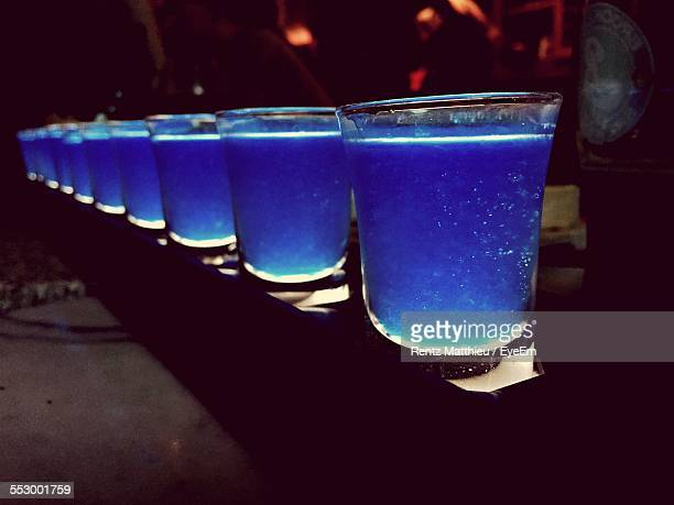 Blue Cocktails On Table In Restaurant