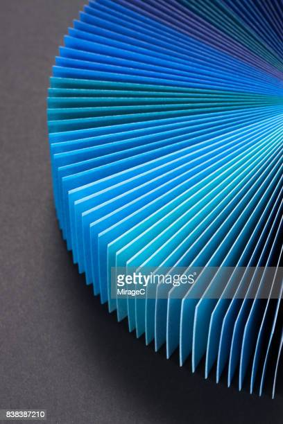 Blue Colored Paper Cards Fan Out Shape