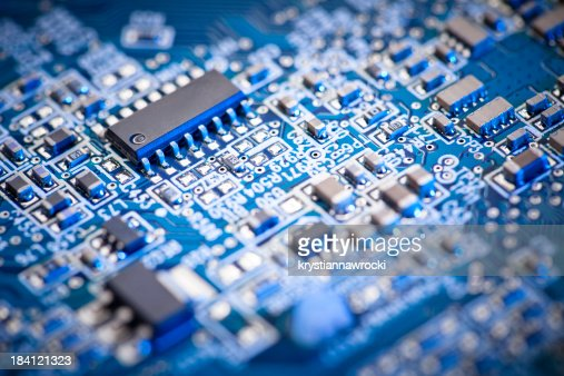 Blue computer circuit board focus set on microchip