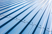 blue corrugated metal roof with rivets, industrial background