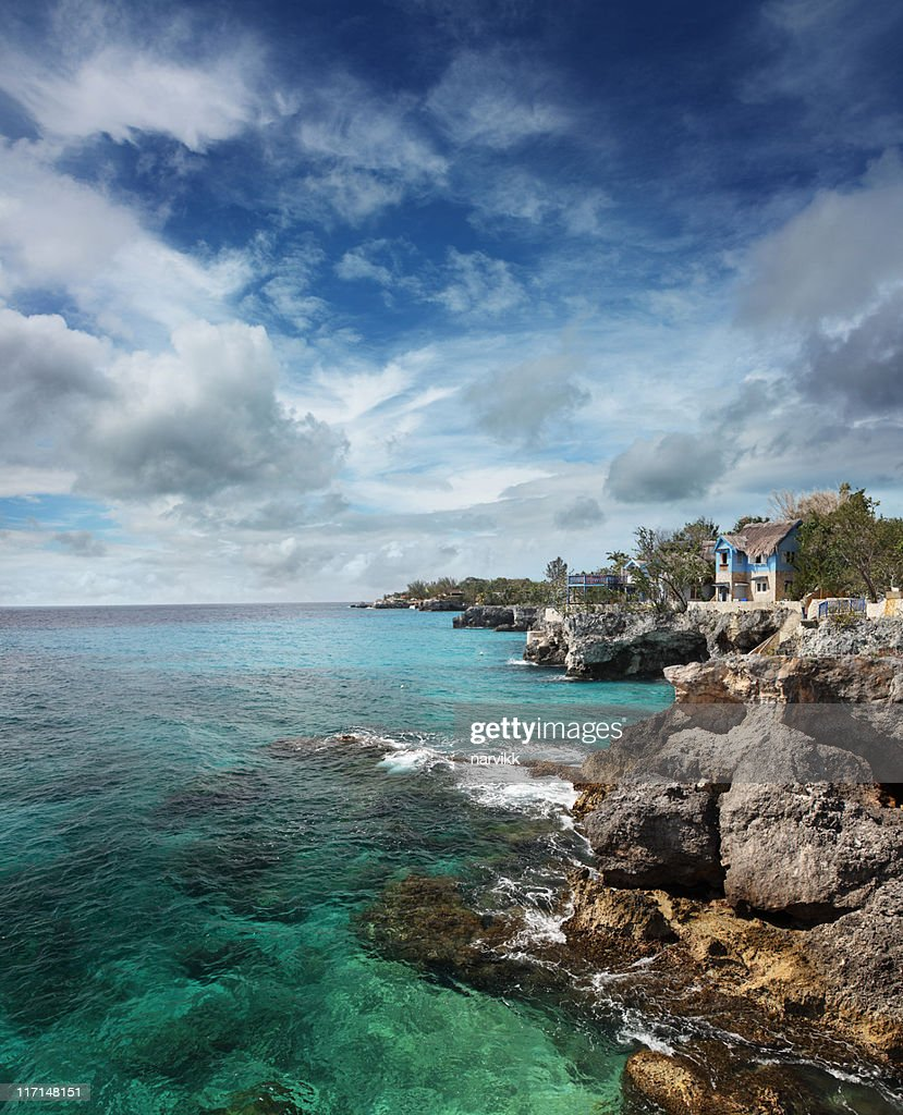 Blue Cottage on the Cliff at Negril : Stock Photo