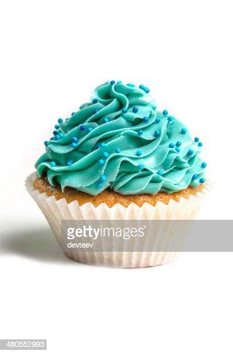 Azul crema que magdalena con glaseado : Foto de stock
