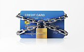 A blue credit card  chained with padlock. There is security stamp on padlock. Horizontal composition with copy space. Front view. Great use for e-commerce, online shopping and security related cocepts