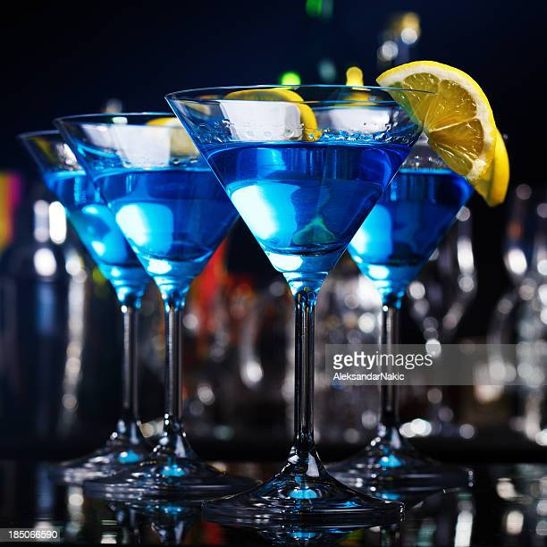 Blue curacao cocktails on a bar counter