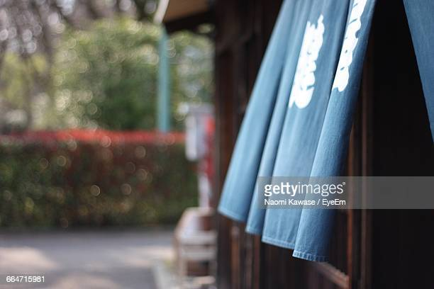Blue Curtain By Window Of Traditional House