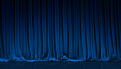 Blue curtain on theater or cinema stage.