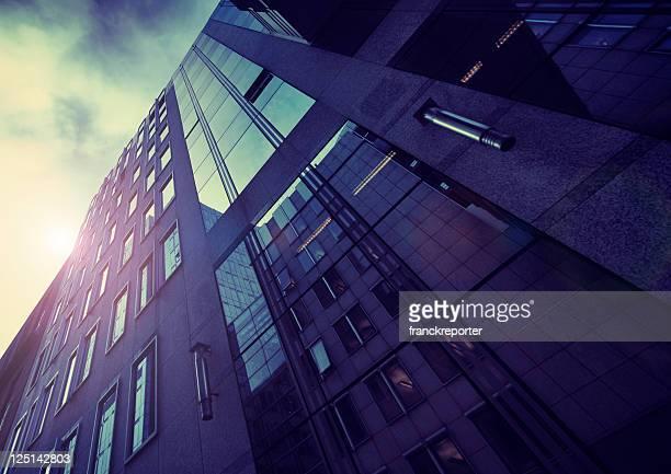 Blue dark skyscraper on modern financial district - HDR