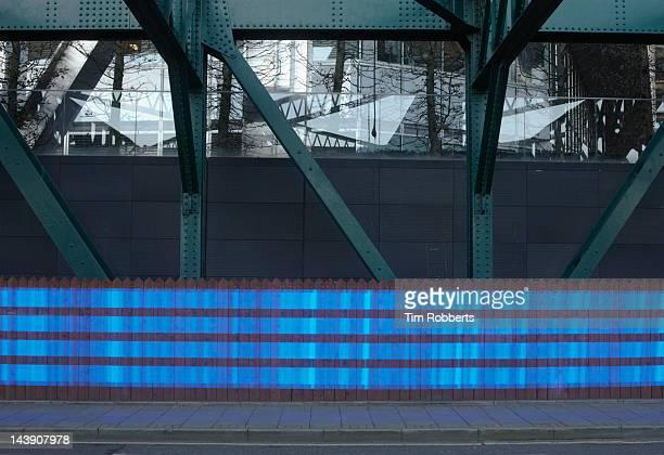 Blue data trail in urban environment.