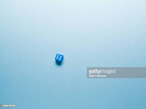 blue dice on surface
