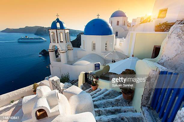 Blue domed churches at Sunset, Oia, Santorini, Gre