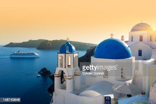 Blue domed churches at sunset, Oia, Santorini