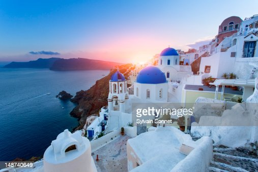 Blue domed churches at sunset, Oia, Santorini