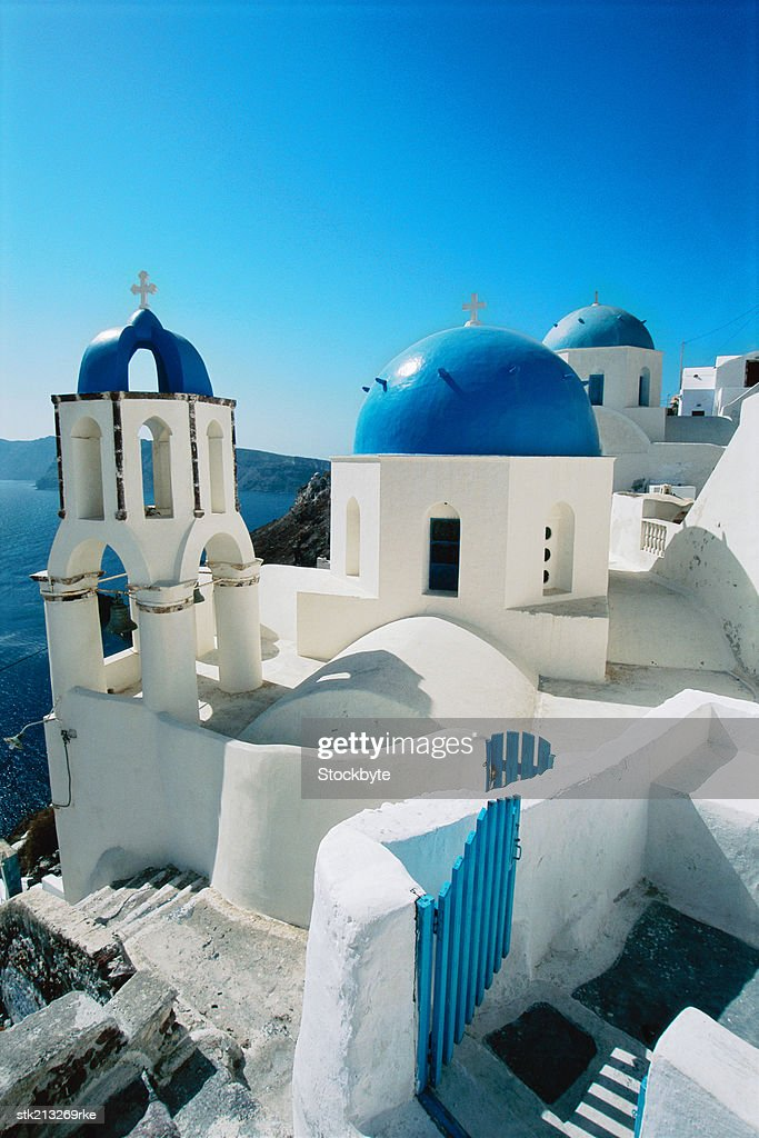 blue domes in the village of Oia Santorini, the Cyclades, Greece : Stock Photo