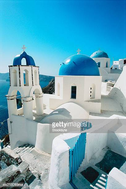 blue domes in the village of Oia Santorini, the Cyclades, Greece