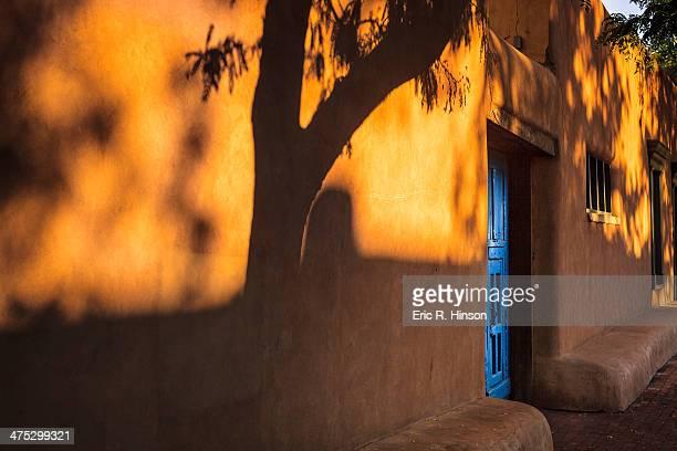 Blue door and adobe shadows