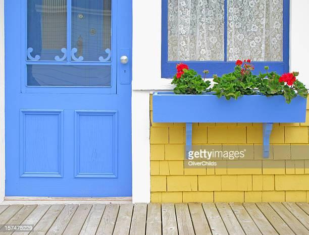 Blue door and window box with Geraniums.