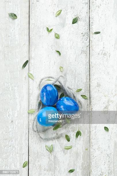 Blue Easter eggs on wood