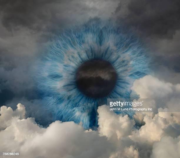 Blue eye in cloudy sky