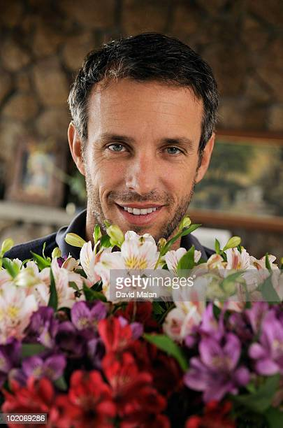 Blue eyed man with a bunch of flowers.