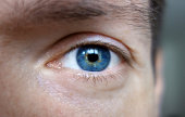 Wonderful blue eyes of a male person