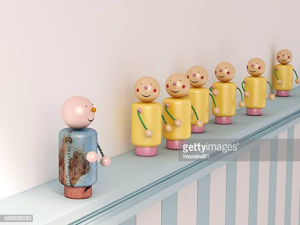 Blue figurine standing on ledge in front of group yellow followers