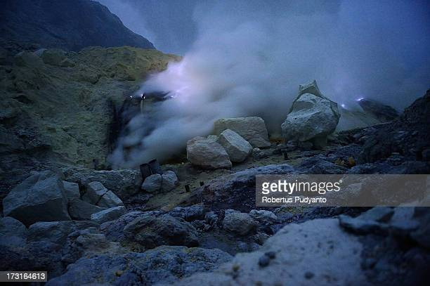 A blue flame is produced by the combustion of sulfur on July 9 2013 in Arjuna Java Indonesia Ijen Crater which is known as Kawah Ijen is located in...