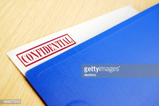 Blue folder with a confidential document inside