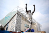 A blue football is added to the statue of Billy Bremner with the help of Leeds United FC ahead of the Reds v Blues weekend of football this summer at...