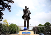 A blue football is added to the statue of Don Revie OBE with the help of Leeds United FC ahead of the Reds v Blues weekend of football this summer at...