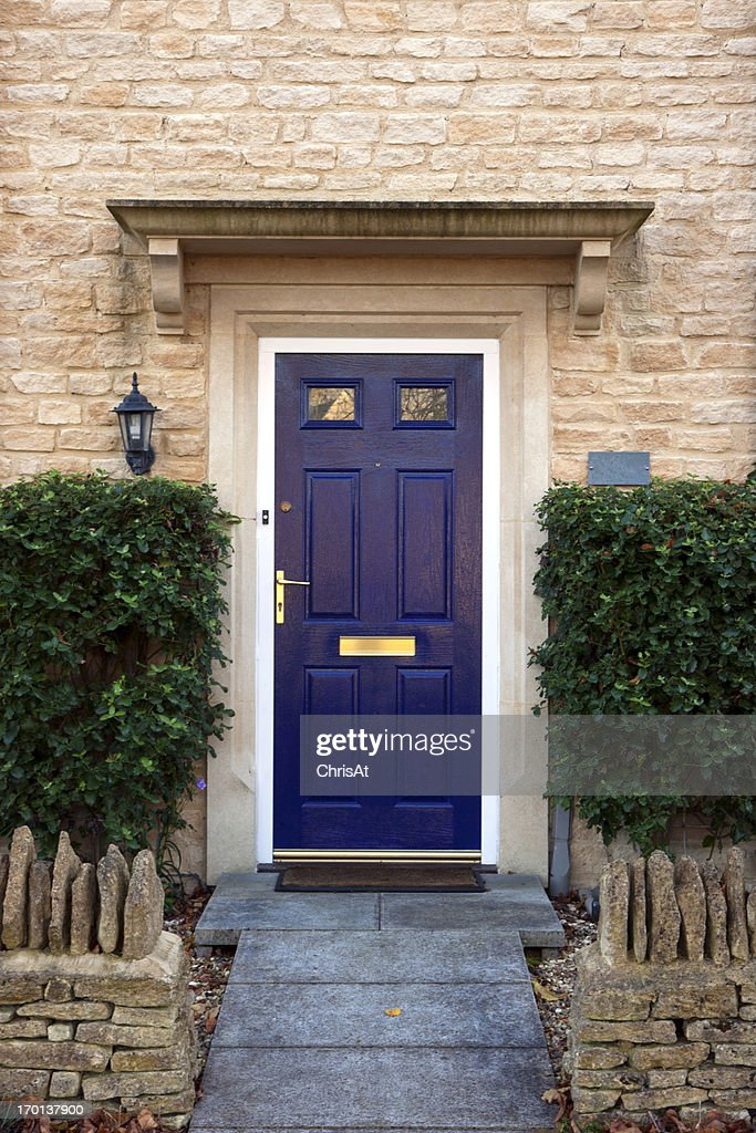 A blue front door on a nice looking house