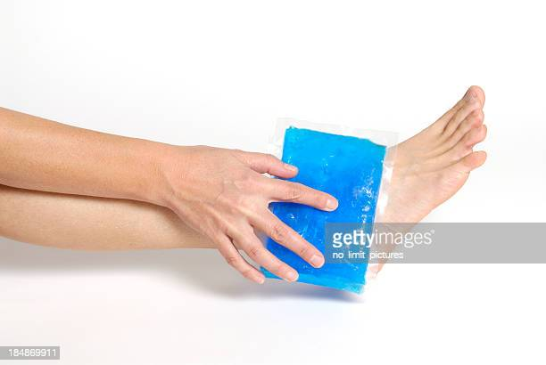 Blue gel pack applying on an ankle on white background