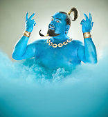 Blue genie came out of the lamp with smoke