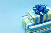 Blue gift boxes with blue ribbon. Copy-space and shallow DOF.