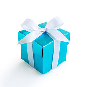 Blue gift box with white ribbon bow on white background