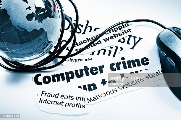 Blue glass globe paperweight, mouse on computer crime headlines