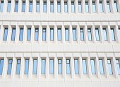 Blue glass in a pale cement building facade Abstract pattern