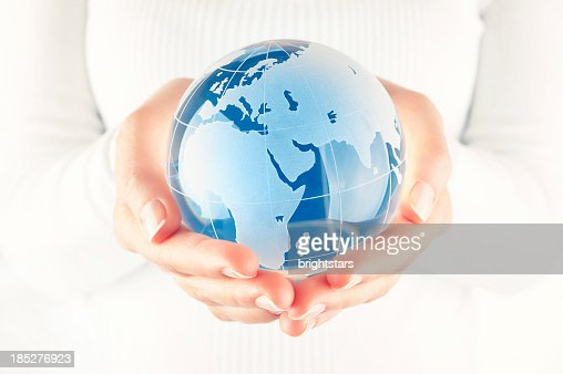 Blue globe in cupped hands