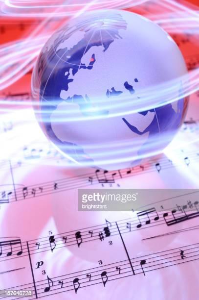 Blue globe on sheet music