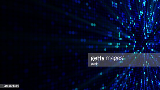 Blue glowing circle pixels on edge of LED screen : Stock Photo
