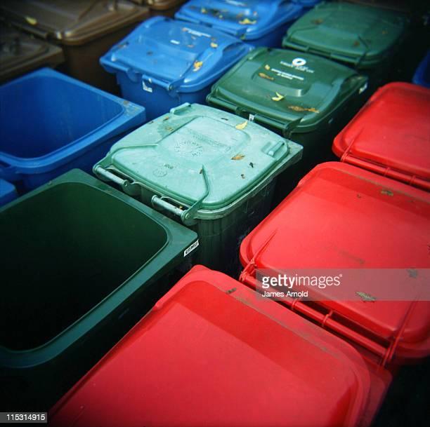 Blue, green and red garbage, wheelie bins