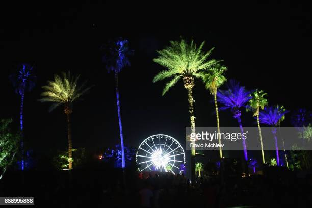 Blue green palm trees and the ferris wheel are seen during day 2 of the Coachella Valley Music And Arts Festival at the Empire Polo Club on April 15...
