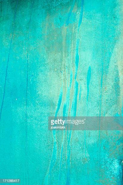Blue grunge background with stains and leaks