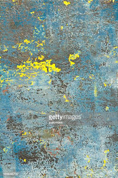 Blue grunge painted background with erosion stains