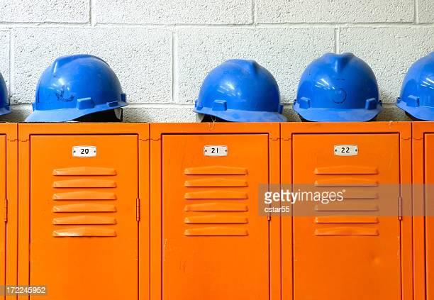 Blue Hard Hats on top of orange Lockers